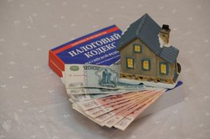 Как оплачивается земельный налог при продаже участка